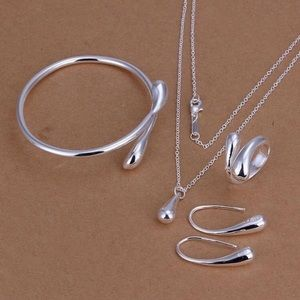 Silver set of four pieces necklace,earrings,ring